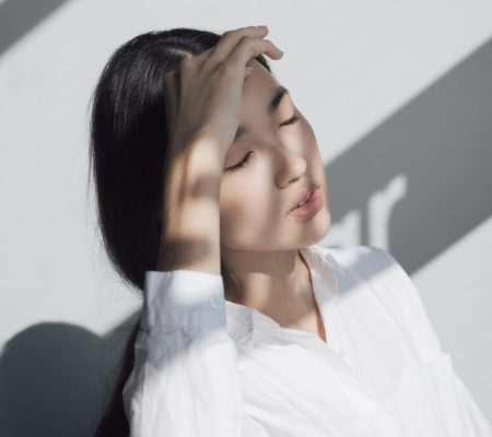 asian woman with head ache